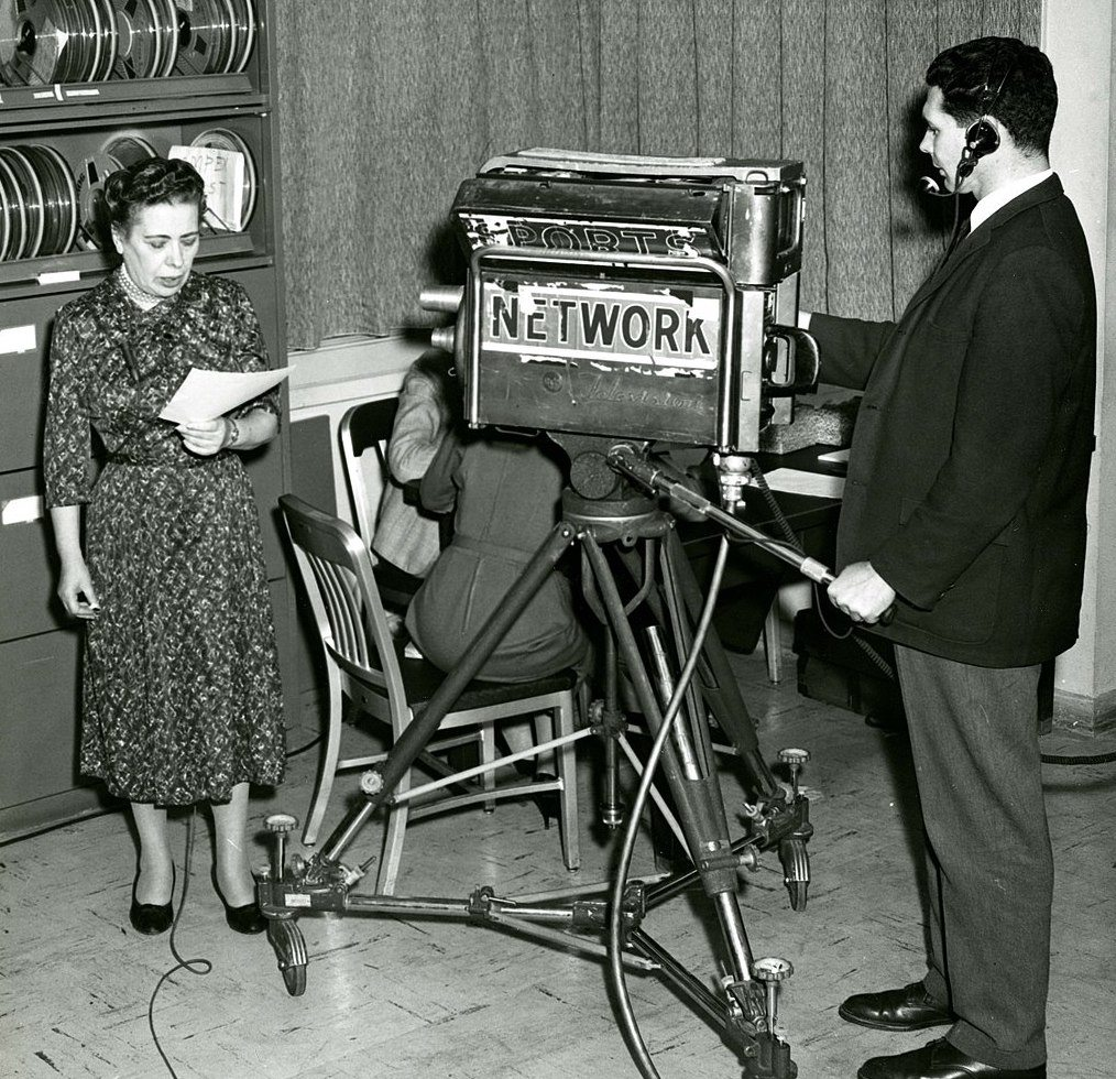 National Bureau of Standards (NBS) mathematician and computer expert Ida Rhodes demonstrates her pioneering work in computer translation of languages. Rhodes was among the first to realize the importance of parsing sentences and separating the roots of words from their prefixes and suffixes as initial steps in the process of computer translation.